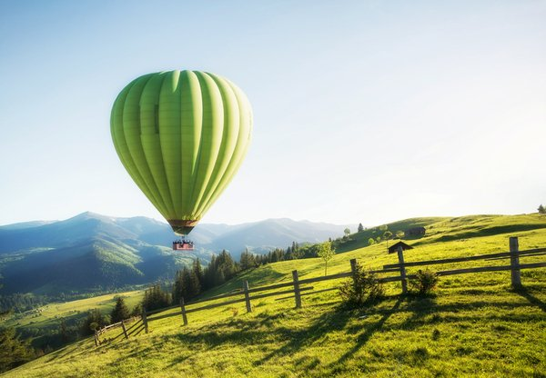 green hot air balloon over field