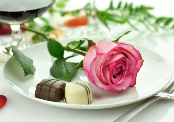 rose on plate with chocolates